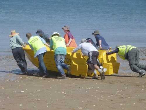 Heave Ho!!! Rescuing the stranded boat.