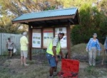 Smiley has reasons to smile after the Butchulla boys helped FIDO relocate the Eurong sign shelter for weeds and community notices.