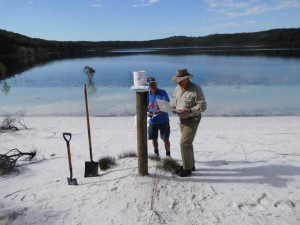 Setting up the Lake McKenzie (Boorangoora) rain gauge that had to be located in a clear open area away from people