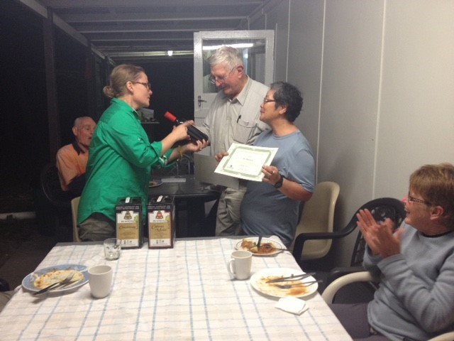 John and Sue receiving their certificate of appreciation, and a nice bottle of Shiraz