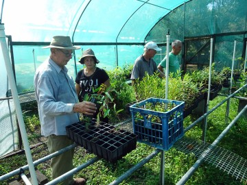 John Sinclair and Suzanne Wilson inspecting the Nursery with FIDO volunteers in February