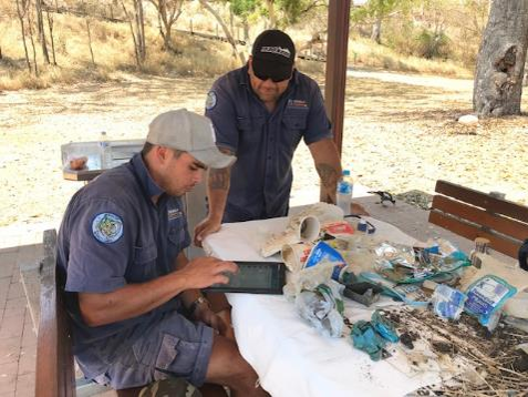 Text Box: Butchulla Land and Sea Rangers uploading marine debris information onto AMDI app (Photo: ReefClean)